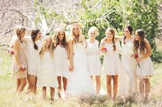 love love love all the bridesmaides in white and different dresses!
