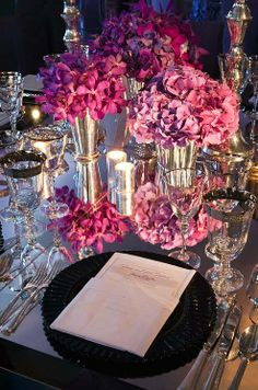 Think: Mirrored table runner and shining vases. Reflective surfaces add a big dose of style and glamour.