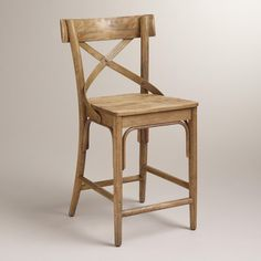 """Authentic and affordable, our vintage-inspired French Bistro Counter Stool is reminiscent of one you'd find in a Parisian patisserie. Crafted of distressed hardwood, it features swooping """"X"""" detailing and a wide, flat seat."""