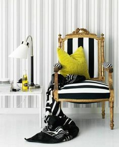 Armchair black and white stripes pillow blanket reading lamp