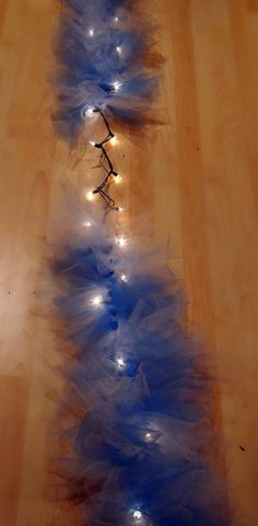 ThanksGarland made with Christmas lights and tulle .... awesome pin