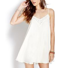 Lace trapeze trim slip dress Super cute. Never worn. Brand new without tags. No flaws. Cream color Free People Dresses Mini