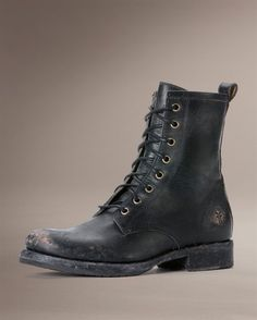 Steel toe doc  martins. A pair of these, some ripped up fish nets, cut off jean shorts, flannel shirt, braided hair, and I was ready for Lolapolooza.