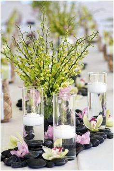 river rock -- love this idea if you're doing a long banquet table for the reception