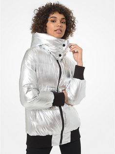 Silver Ribbed-Trim Puffer Jacket Michael Kors.  Crafted with a high-gloss silver finish this puffer jacket is accented ribbed trims at the cuffs and hem and features a generous hood that can also be worn as a funnel-neck collar.   #Fashion #LookBook #OutfitOfTheDay #LookOfTheDay  #Fashionable #FashionStyle  #FashionAddict #FashionLover #Fashionista #FashionStylist