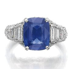 G, BULGARI, 1970S. Set with a cushion-shaped sapphire weighing 5.50 carats, brilliant-cut and baguette diamonds, size 521/2, signed Bulgari.