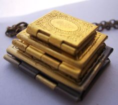 Stack of Books - the book lovers locket necklace - 3 vintage brass lockets -. $26.00, via Etsy.