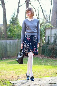 Lace tights, floral skirt, crochet collared shirt worn under a sweater.
