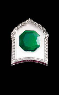 Brooch by JAR, 2002. Gold, set with emerald, diamonds, rubies, rock crystal and white agate