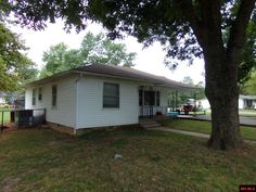 AFFORDABLE 2 BEDROOM 1 BATH HOME with hardwood floors, freshly painted interior, chain linked fenced level backyard, corner lot, all city utilities with updates like a new roof in 2011, new heat/air in 2015. Come take a look! in Flippin AR