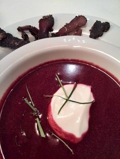 Beet Chocolate Soup Micro 6 beets in 2c boiling water. Peel. Add 2T cacao, 2t burnt paprika, 1/2t cumin, 1/2 t coriander, 2T olive oil. Blend until pureed. Stir in 2c coconut milk. Add 1t lime juice - twangy aftertaste. Cut 2 lemon leaves in thin strips, cross-grain. Add half to soup, keep rest for garnish. To serve: heat in micro to boiling hot; dish into soup bowl, add scoop of greek joghurt, Garnish with lemon leave strips. Serve with biltong, droewors, Replace lemon juice leaves with…
