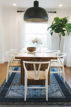 Wishbone chairs and navy rug    Studio McGee