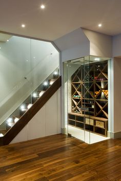 Temperature-controlled wine room under basement stairs