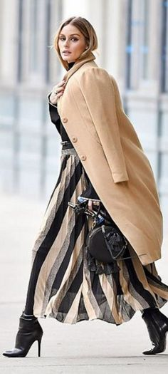 Who made Olivia Palermo's black round handbag, pleated stripe skirt, top, ankle boots, and tan coat?