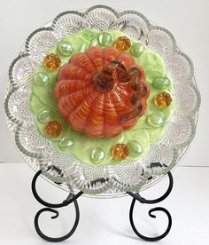 Vintage Repurposed Glass and Ceramic Flower Yard Art With Orange Blown Glass Pumpkin