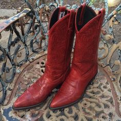 Rockin' Red  Leather Cowgirl Boots Deep Red and loaded with stitching in these size 6 cowgirl boots by code West.   There's just something about a gal in Red Boots.  These are great with jeans, a dress or smoking hot with shorts.  These have some wear, but in still in fabulous condition and ready to dance across the floor.  Size 6 Code West Shoes