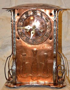 English Arts and Crafts copper clock, H.A.C. factory, 14 in. h.