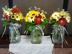 Rustic bright mason jar centerpieced for country themed rehersal dinner