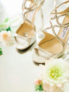 Gold Jimmy Choos wedding shoes