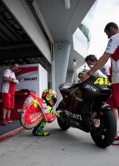 Valentino Rossi...communicating with his ducati.