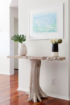 A petrified wood side table? It looks like Genna just traipsed off to the nearby beach and picked it up.
