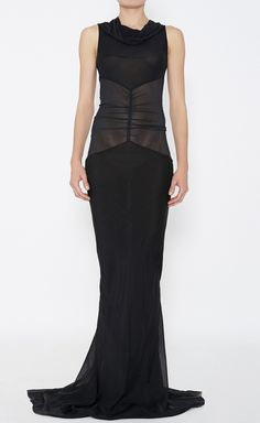 A little Morticia Addams, but it sure emphasizes a good waist.