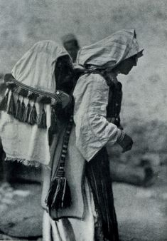 """Peasant woman at Saint Anne's [Shën Ana] with a cradle on her back. The wooden cradle is covered with a veil to protect the child from the flies"" (Photo: Hugo Bernatzik, 1929)."