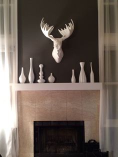 Ah, love my new fireplace! Painted Vases, Traditional Fireplace, Interior Decorating, Spray Paint Vases, White Spray Paint, Kitchen Paint Colors, Behr Paint, Fireplace, Moose Head Decor