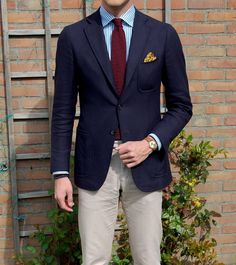 Beige chinos and blue jacket