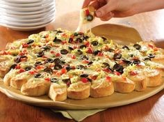 Pull-Apart Pizza Recipe. I first tried this at a Pampered Chef party. It was so good that I've made it a few times since. The directions tell you specific pampered chef items to use, but just use whatever you have on hand. I cook mine on a regular baking sheet.