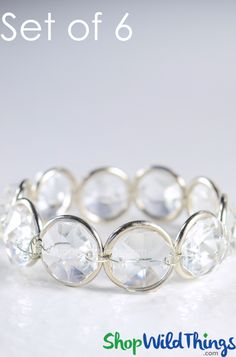 You carefully fashioned your table setting to look attractive and appealing but something's missing.  Details like adding these ritzy Silver and Crystal Napkin Rings are just the right touch to elevate