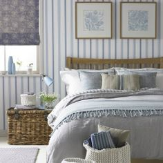 Pale country blue striped bedroom with wooden bed with oversized headboard, wicker bedside table, patterned blind and framed pictures. Bedroom Color Schemes, Bedroom Colors, Colour Schemes, Home Bedroom, Bedroom Decor, Bedroom Country, Bedroom Ideas, Bedroom Furniture, Cottage Bedrooms