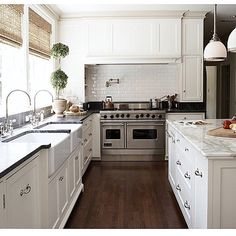 """Kristy Wicks • Wicks Nest on Instagram: """"When one farmhouse sink just isn't enough, @ashleygoforth designs a kitchen with 2... This beautiful Houston home also shines with 2 different countertop materials ~ Calacutta marble on the island and Soapstone everywhere else. The rich contrast of the floors grounds this gourmet kitchen. Love this Ashley! ❤️"""""""