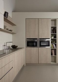 Back to a minimal kitchen, but with some warmer colors for these built-in cabinets. The drywall reveal around the ovens ensure a clean line and corner turn without the weird upper corner cabinet that dates most kitchens. #ThisOldHouse inspiration via www.L-2-Design.com
