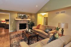 The Trent living room.  Open-concept with stone fireplace, vaulted ceilings, wood flooring....colourful.  www.qualityhomes.ca