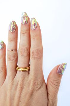 We love how her manicure is paired up with her rings, check out this broken glass DIY
