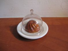 For the doll house: minature glass bell with a turban (cake) on a sign marked...