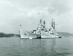 80-G-424598. USS Toledo (CA-133) and USS Juneau (CLAA-119). Moored at Naval Operating Base, Yokosuka, Japan, following Korean War operations. Photographed during July-October 1950, possibly in late October, just before Toledo departed Yokosuka to return to the U.S. for overhaul. Note the comparative sizes of these two cruisers. Official U.S. Navy Photograph, now in the collections of the National Archives.
