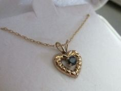 The sapphire is mounted in the center of the heart, very pretty pendant and chain EverythingIOwn http://etsy.me/YoELaD @Etsy