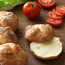 """These deli-style """"bulky rolls"""" are perfect for over-stuffed sandwiches. Top them with sesame or poppy seeds for that authentic """"bakery look"""" Kaiser Roll Recipe, Sesame Seeds Recipes, Hard Rolls, Bread Machine Recipes, Bread Recipes, Flour Recipes, Homemade Rolls, Pretzels Recipe, Sicilian Recipes"""
