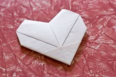 how to fold a note into a paper heart :} (yeah, i couldn't remember how to fold them)