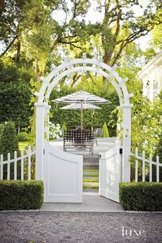 I would love a graduated picket fence and arched trellis with a gate door to enter our back yard on the North side. Picture perfect for me!: