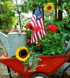 Dandi Gentry 'contains' her vignette in a wheelbarrow - Modern Design Garden Cart, Garden Junk, Garden Planters, Garden Ladder, Side Garden, Wheelbarrow Planter, Flea Market Gardening, Red Geraniums, Diy Store