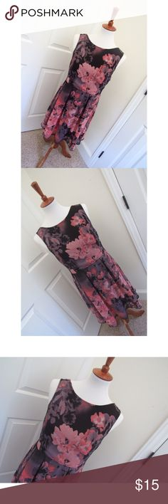 Anthropologie Band of Gypsies dress Black and pink floral Anthropologie Band of Gypsies dress. It has a V cut back, and is in brand new condition. No flaws, no damage, no stains. It has a synch in the waist which brings for a more slimming look.  - I don't trade or sell outside of posh. - I ship every single day!  - All items come from a smoke free home!  - If you have anymore questions just let me know and I would be happy to help! 🙂 Anthropologie Dresses