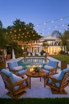 Perfect yard: Balcony, string lights, elongated pool/grass, etcetera