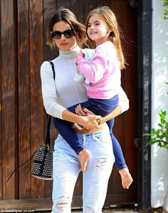 Party: Supermodel Alessandra Ambrosio accompanied her fiance and children to a party on Sunday