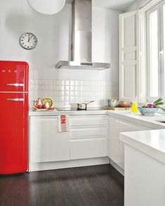 white with red smeg and turquoise and yellow touches. Love the clock and lack of overhead cabinetry....