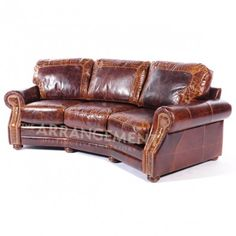 Trail Boss Angle Sofa  The Arrangement - Trail Boss Angle Sofa - Distressed fine leather creates an interesting dialogue with contrasting stamped cowhide crocodile accents . The gentle angle of seating makes for wonderful conversations.
