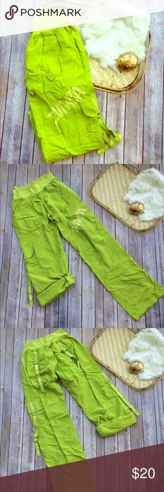 Neon Green Zumba Cargo Convertible Pants Lime green Zumba cargo style pants. Convert from pants to capris. Size medium. 100%nylon. Stretchy waist band.  •I don't swap/trade •I don't do holds  •I rarely model due to the fact that I don't fit all items.  •I price with shipping in mind  •I am open to reasonable negotiations  •Bundle for the best deals  ☮   ❤️   😊 Zumba Fitness Pants