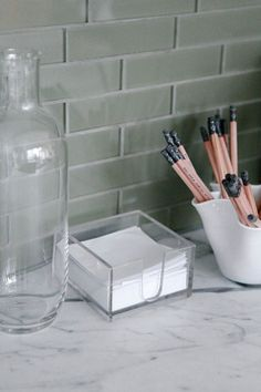 Make Task-Dedicated Spaces - 20 Things People With Clean Apartments Always Do - Lonny Cubbies, Lonny, Apartment Cleaning, Cleaning, Kitchen Must Haves, Glass, Glass Boxes, Home Decor, Wall Unit
